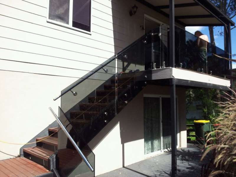 Frameless Glass tinted with Stainless Steel handrail.