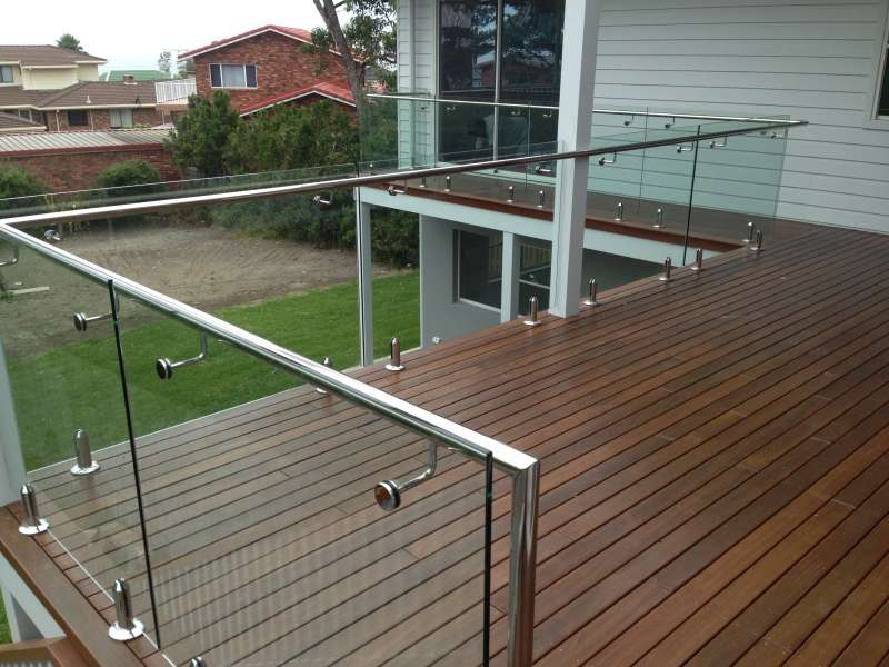 Stainless steel handrails on frameless glass.